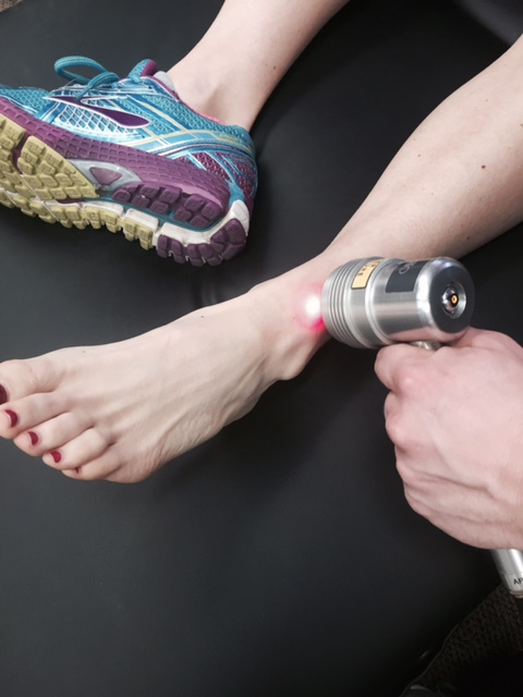 Cold Laser Therapy being used on an ankle